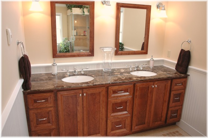 custom design bathroom vanity matching mirrors tub panel cabinetry