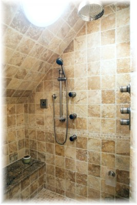...No wait - relaxing in this inviting custom shower with built-in bench and naturaly lite from a skylight and...