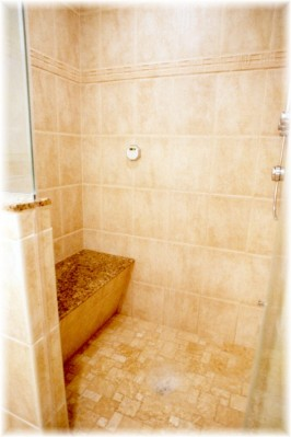 Close-Up View of Built-In Bench & Shower Floor